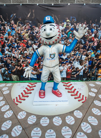 Homer, the Miracle League mascot, was custom designed out of concrete and hand-painted by Landscape Structures' artists.
