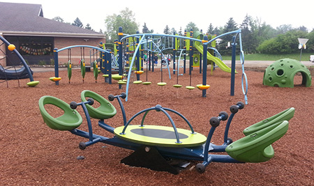 The We-saw™ is just one of the inclusive playground components at Thornton Creek's new inclusive playground.
