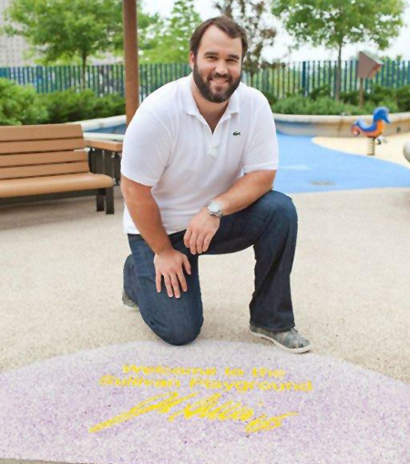 Vikings Center John Sullivan welcomes patients and their siblings to the inclusive playground at University of Minnesota Amplatz Children's Hospital.