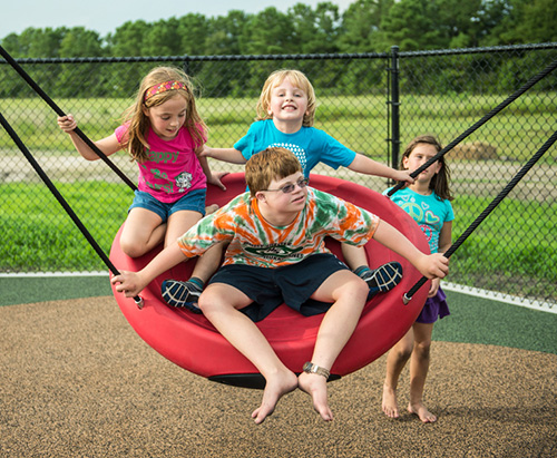 The Oodle® Swing encourages healthy interaction among children of all abilities.